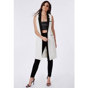 Monochrome sleeveless blazer - £40