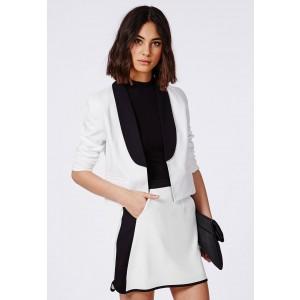 Cropped white blazer - £30 Mini skirt - £20